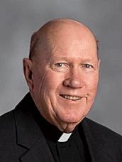 Rev. James E. Quill